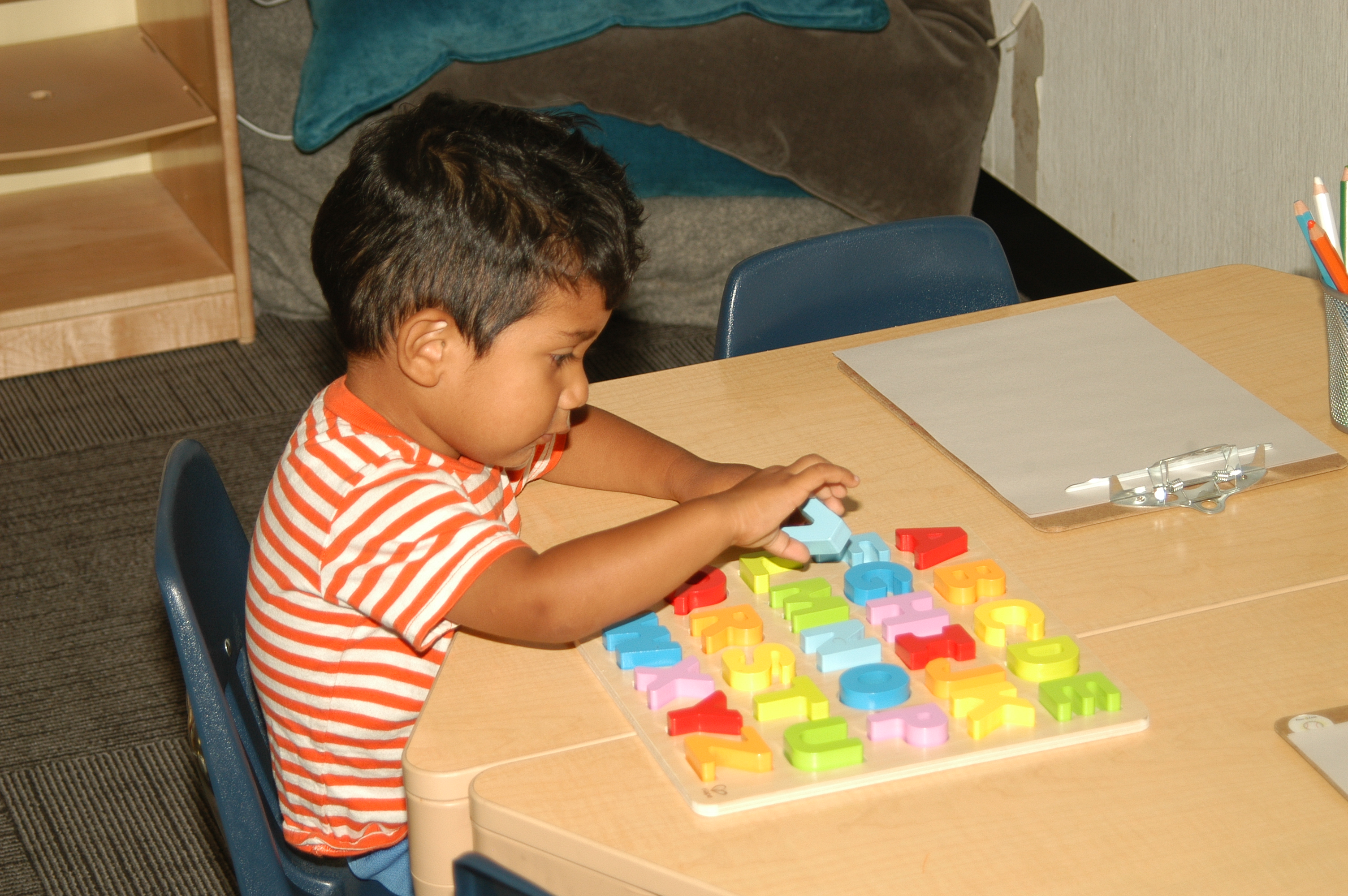Children's Center - Child Playing with Letters
