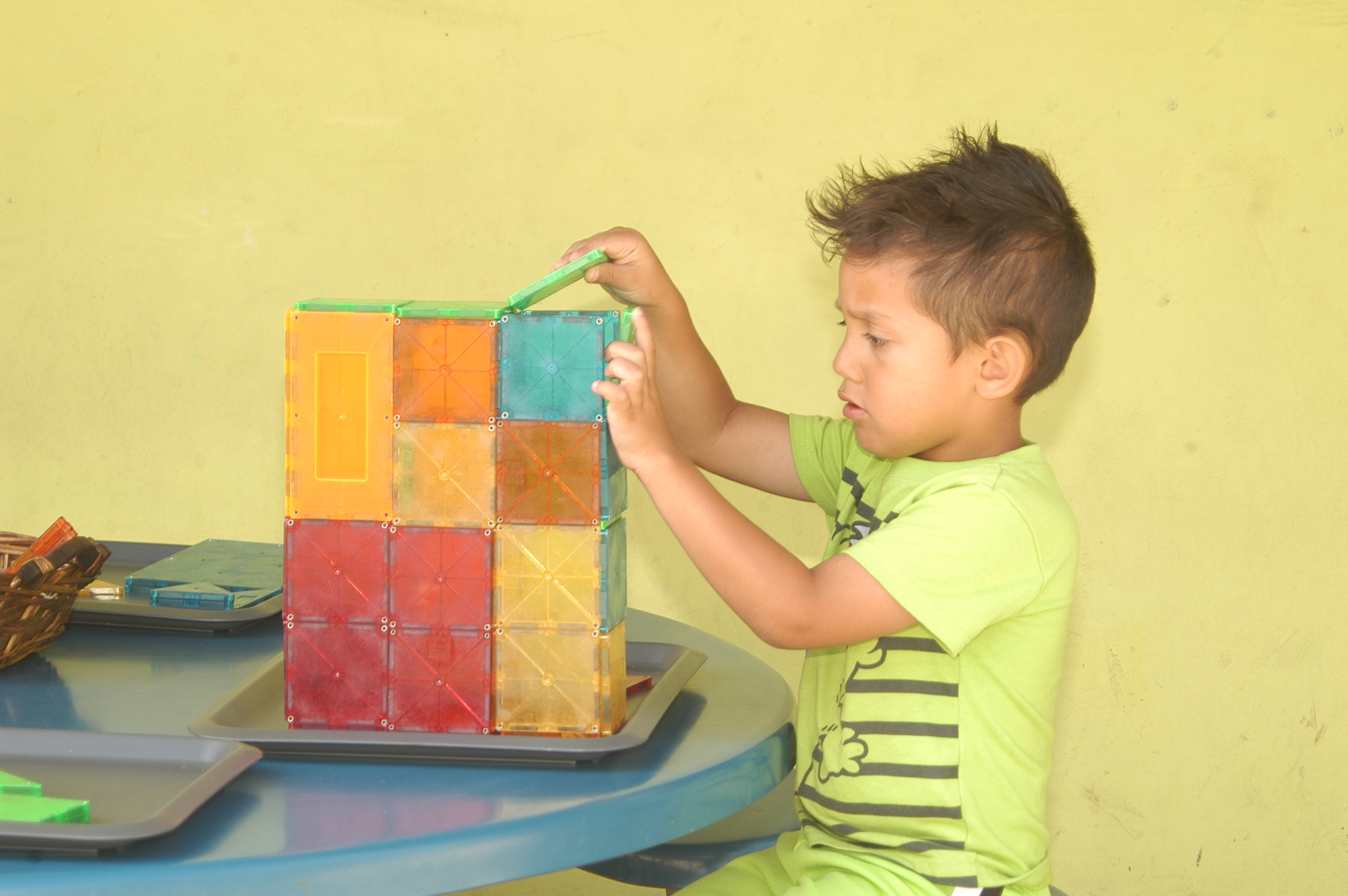 Children's Center - Child Playing with Blocks